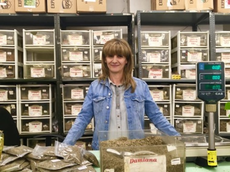 Long-time employee Rita Martinez, proudly stands behind her desk. She consults with dozens of clients daily and helps them figure out what types of herbs and plants are best depending on their ailment.