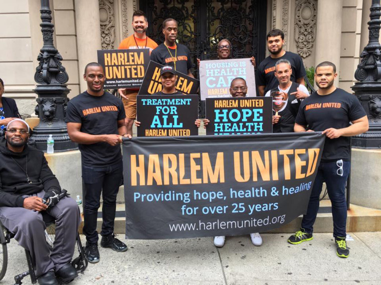 Image: Participants hold Harlem United banners during  the African American Heritage Day parade in Harlem