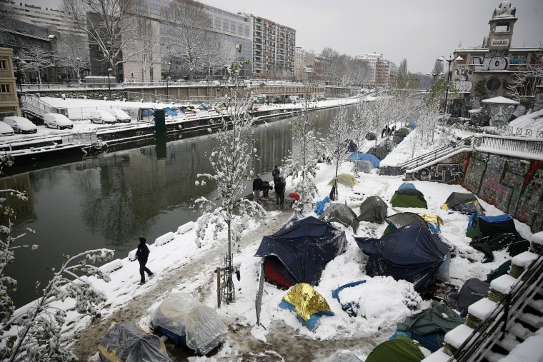 A makeshift migrant camp is blanketed in snow along Saint-Martin canal Feb. 7.