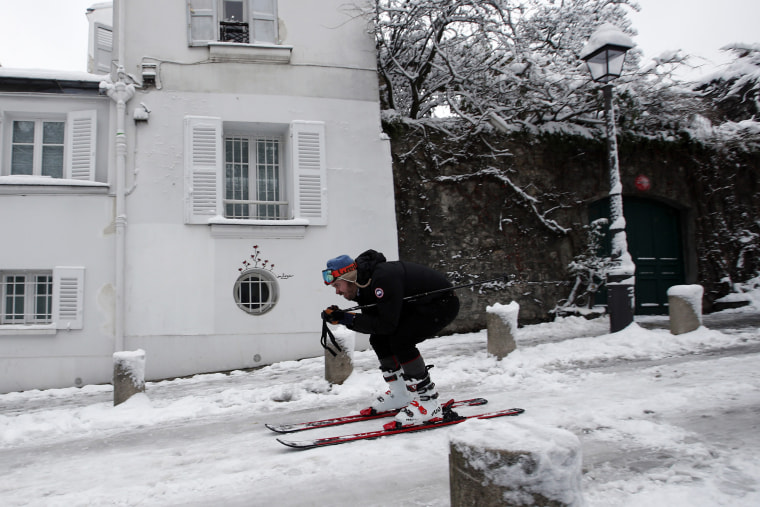 A man skis down a street in Montmartre on Feb.7.
