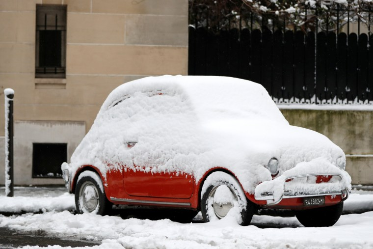 A classic Fiat 500 remains parked on Feb. 7.