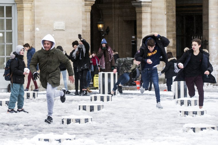 Students play in the snow in the Colonnes de Buren in Paris on Feb. 7.