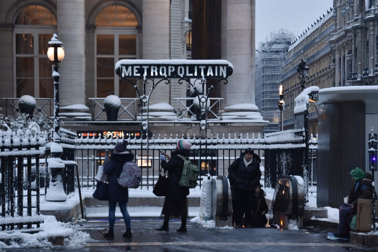 People stand outside an entrance to a metro station on Feb.7.