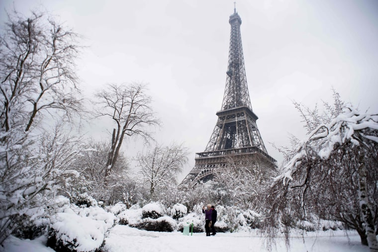 People walk through the Champ de Mars garden on Feb. 7.