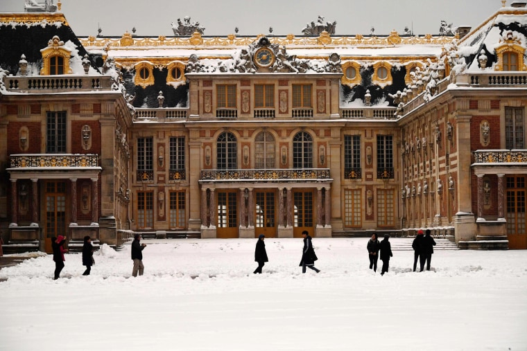 People walk outside Versailles on Feb. 7, outside of Paris.