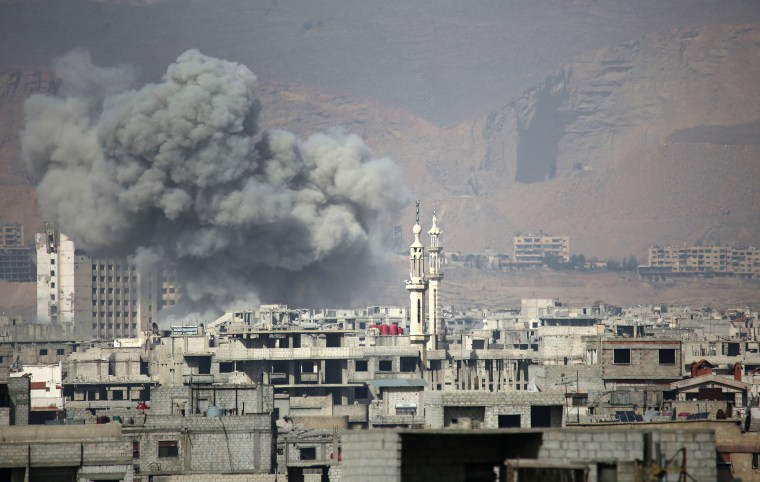 Clouds of smoke billow into the sky following an airstrike in the rebel-held town of Arbin, in the besieged Eastern Ghouta region on Feb. 7.