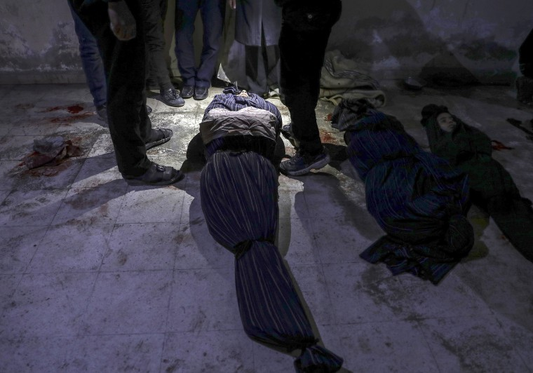 The bodies of people killed lie inside a morgue in Douma on Feb. 6.