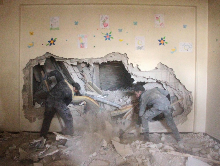 Men look for survivors amid the rubble in Douma on Feb. 6.