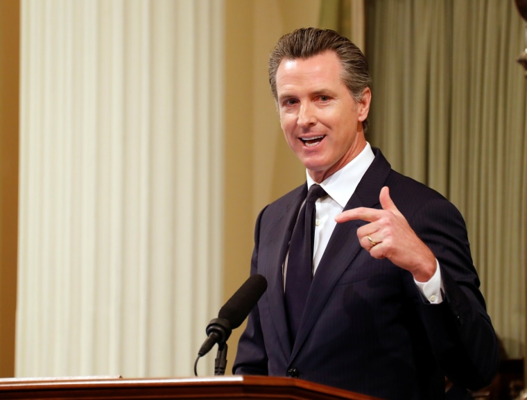 Image: Lt. Gov. Gavin Newsom speaks before introducing California Gov, Jerry Brown who was delivering his final state of the state address, ending his fourth term as governor in Sacramento