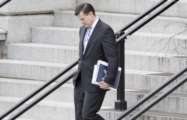 Image: Trump transition team member Rob Porter walks outside the Eisenhower Executive Office Building following meetings, at the White House complex in Washington, DC, Jan. 13, 2017.
