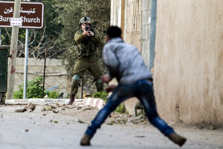 A Palestinian protester confronts an Israeli soldier during an army search operation in the Palestinian village of Burqin, West Bank, on Feb. 3.