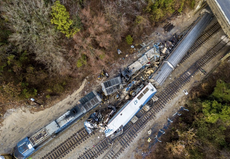 An Amtrak passenger train slammed into a parked freight train in the early-morning darkness after a thrown switch sent it hurtling down a side track in Cayce, SC., on Feb. 4. Two Amtrak crew members were killed, and more than 100 people were injured.