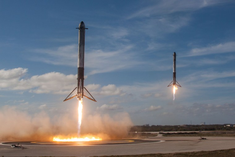 The solid rocket boosters of SpaceX's first Falcon Heavy rocket come back for landing at the Kennedy Space Center in Florida on Feb. 6. With liftoff, the Falcon Heavy became the most powerful rocket in use today, doubling the liftoff punch of its closest competitor.
