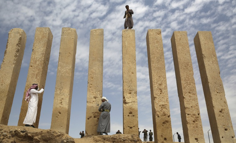 A Yemeni militiaman stands on a limestone column at the Awwam Temple in Marib, Yemen, on Feb. 3. The Awwam Temple links a region now on the front lines of the Saudi-led war against Shiite rebels to Arabia's pre-Islamic past, a time of spice caravans and the mysterious Queen of Sheba.