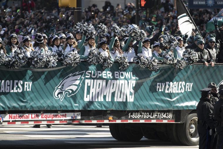 Philadelphia Eagles NFl football team cheerleaders waves during a Super Bowl victory parade on Feb. 8, 2018, in Philadelphia.
