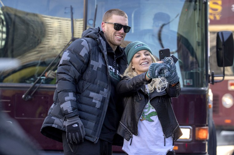 Philadelphia Eagles NFL football player Zach Ertz, left, stops to take a photo with his wife, Julie Ertz, during a Super Bowl victory parade on Feb. 8, 2018, in Philadelphia.