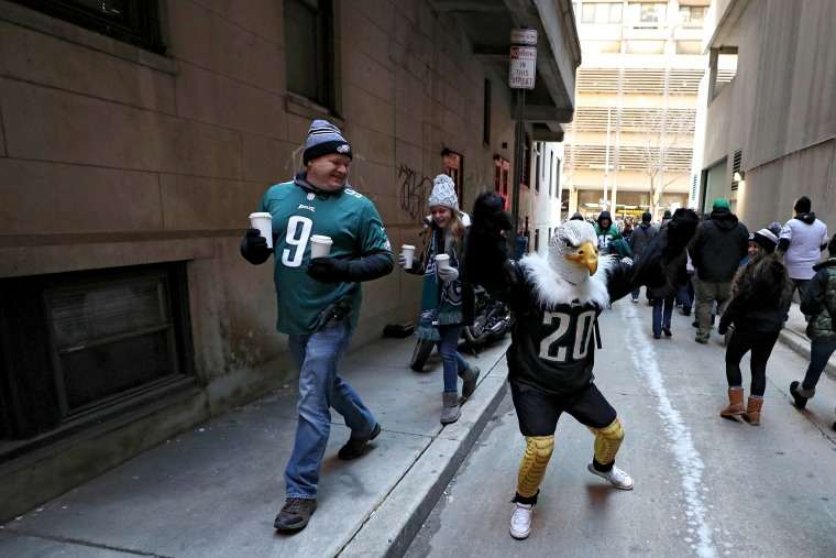 Fans celebrate with the Philadelphia Eagles during their NFL Super Bowl victory parade on Feb. 8, 2018 in Philadelphia.