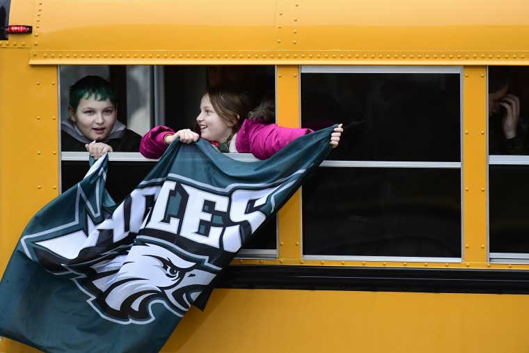 Passing fans fly an Eagles flag before festivities on Feb. 8, 2018 in Philadelphia.
