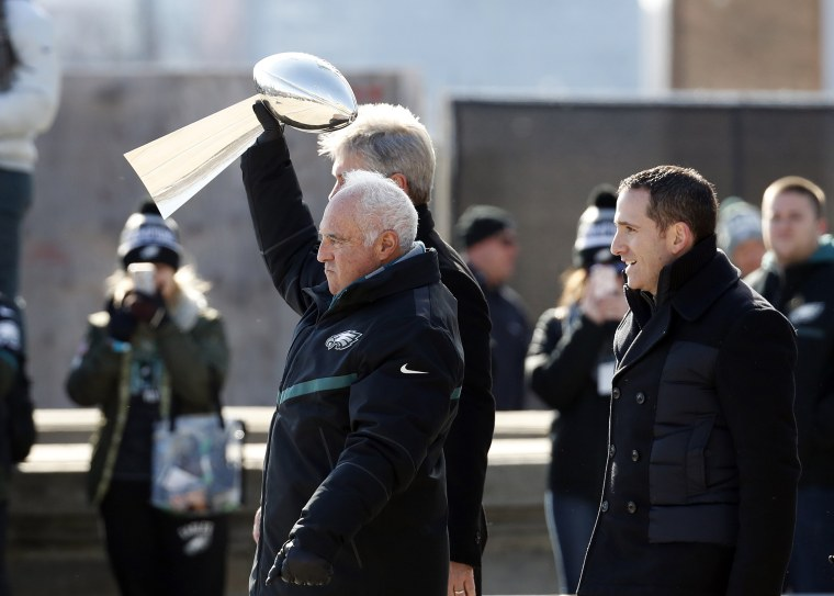 Philadelphia Eagles owner Jeffrey Lurie holds the Vince Lombardi trophy up with head coach Doug Pederson, behindn and general manager Howie Roseman, right, as they arrive for an event in front of the the Philadelphia Museum of Art after a Super Bowl victory parade for the Philadelphia Eagles football team on Feb. 8, 2018, in Philadelphia.