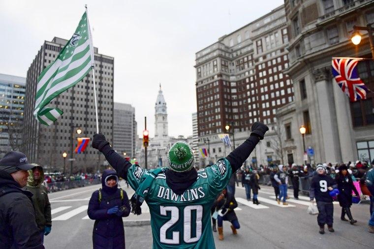 Brian Williams of Glocester City waves his flag before festivities begin on Feb. 8, 2018 in Philadelphia.