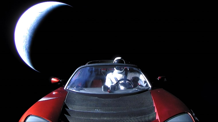 """Starman,"" a dummy driver, sits at the steering wheel of a #Tesla Roadster as it travels through #space leaving #Earth in the distance. The world's first space car was the unorthodox cargo aboard #SpaceX's new Falcon Heavy rocket during a test flight on Tuesday."