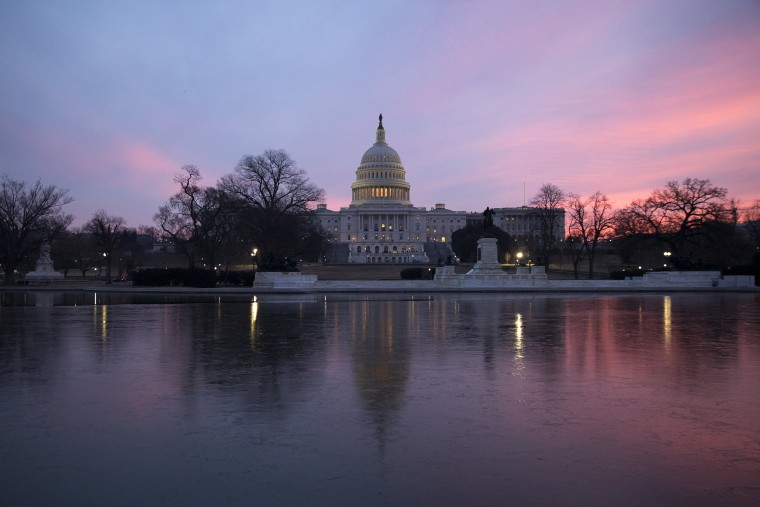 Image: The U.S. Capitol dome at sunrise after an early morning House vote to halt the government shutdown in Washington, DC, Feb. 9, 2018.