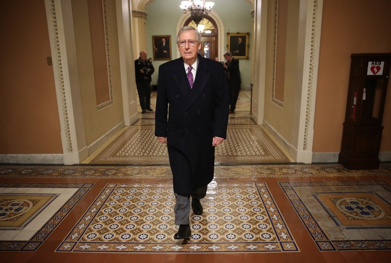 Image: Senate Majority Leader Mitch McConnell (R-KY) returns to the U.S. Capitol just before midnight on Feb. 8, 2018 in Washington, DC.