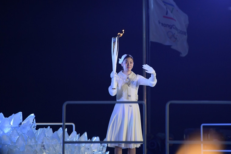 South Korean figure skater Kim Yu-na prepares to light the cauldron with the Olympic Flame.