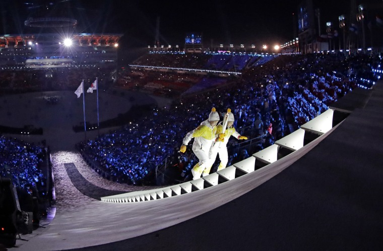 North Korea's Jong Su Hyon, left, and South Korea's Park Jong-ah carry the torch.