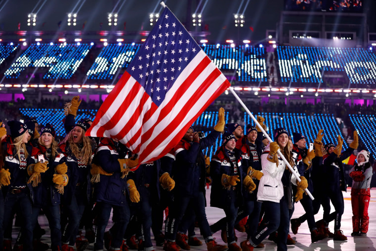 U.S. flagbearer Erin Hamlin leads the delegation during the Parade of Athletes.
