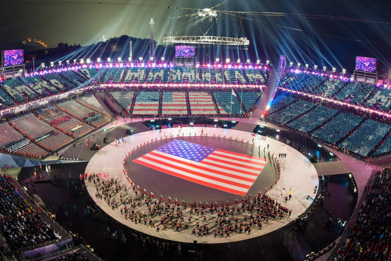 The U.S. delegation parades through the stadium.