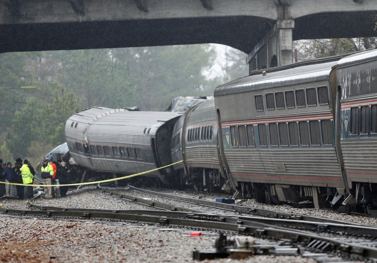 Image: Emergency responders view the damage at the scene after an Amtrak passenger train collided with a freight train and derailed in Cayce