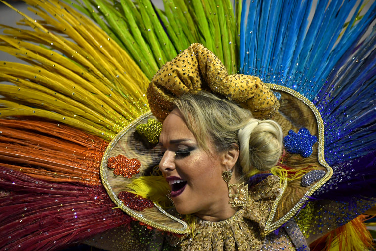 A reveler of the Tom Maior samba school performs during the first night of carnival in Sao Paulo, Brazil, at the city's Sambadrome early on Feb. 10, 2018.
