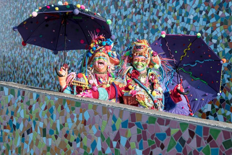 Women celebrate the launch of the hot carnival season on Women's Carnival, Feb. 8, 2018 in Duesseldorf, western Germany.