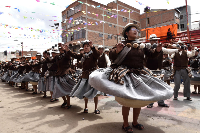 Aymara indigenous people perform traditional Andes highlands folk dances during the Anata Andino harvest festival, ahead of the Oruro Carnival, in Oruro, Bolivia, on Feb. 8, 2018. During the harvest festival, native peasant farmers from different Bolivian highlands communities dance in the streets of Oruro giving thanks to Pachamama (mother earth) for the abundant crops.
