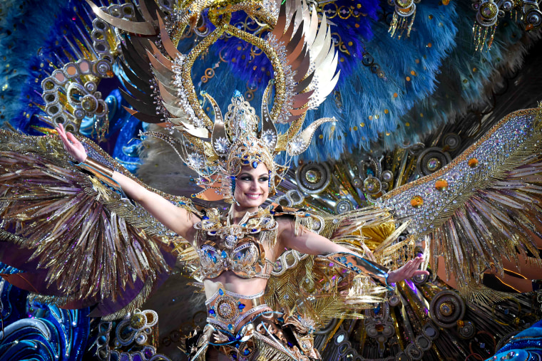 A nominee for queen performs during the main stage of the Carnival of Santa Cruz in Santa Cruz de Tenerife on the Spanish Canary island of Tenerife, on Feb. 07, 2018. The costumes are more than five meters high and over 80 kilos in weight. The event began on January 12 and finishes on February 18 with orchestras playing Caribbean and Brazilian rhythms throughout the festivities that range from elections for the Carnival Queen, the Junior Queen and the Senior Queen, to children and adult murgas (satirical street bands), comparsas (dance groups) and street performances.