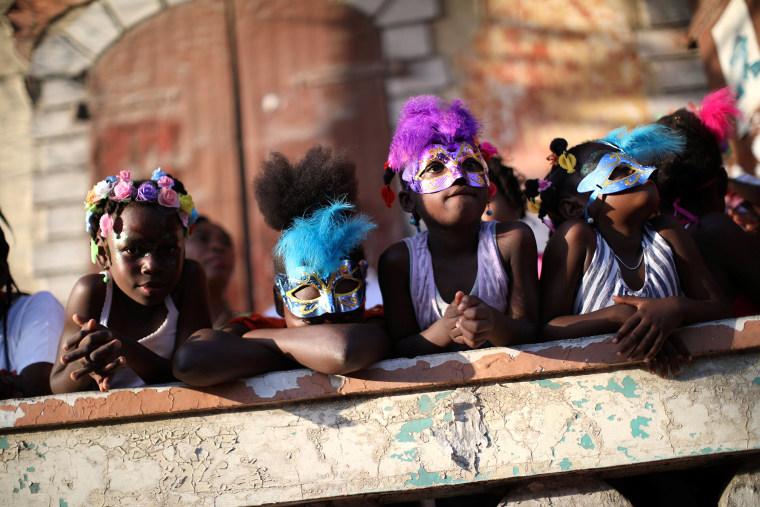 Girls attend a parade along a street at the Carnival of Jacmel, Haiti, Feb. 4, 2018.