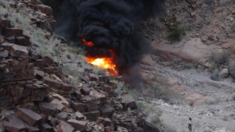 This photo shows the scene of a helicopter crash at the Grand Canyon on Saturday, Feb. 10, 2018. Authorities said three people were killed and four others were injured.
