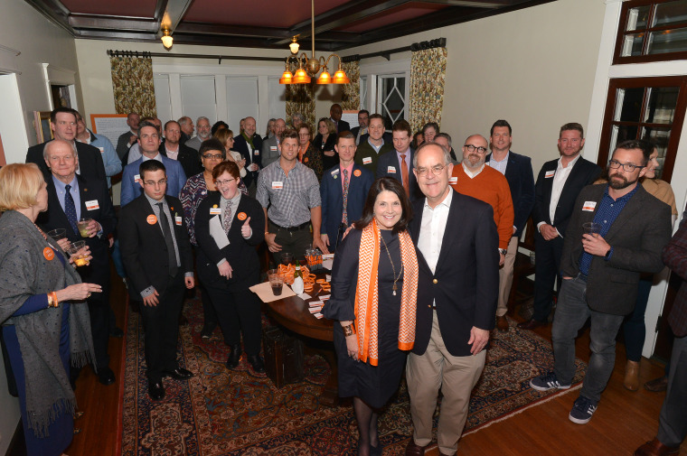 University of Tennessee alumni raise money for the school's LGBTQ Pride Center at a private home in Nashville, Tenn., on Feb. 1, 2018. They are joined by U.S. Rep. Jim Cooper and U.T. Chancellor Beverly Davenport.