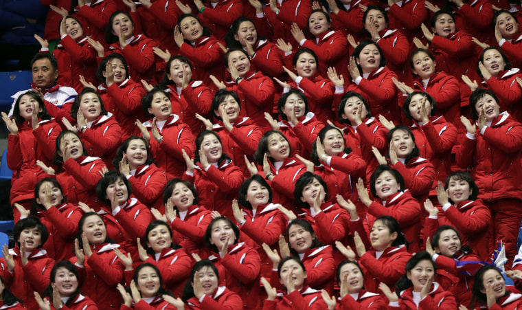 North Korean supporters cheer on Un Song Choe, of North Korea, during the 1,500 meter short-track speed skating on Feb. 10.