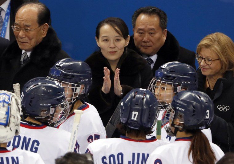Kim Yo Jong claps next to Kim Yong Nam during the women's preliminary round ice hockey match between Switzerland and the Unified Korean team on Feb. 10.