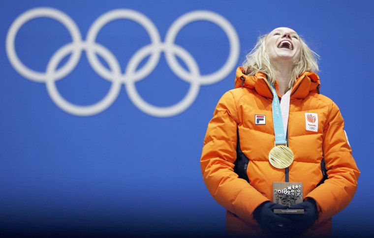 Gold medalist Carlijn Achtereekte of the Netherlands smiles during the medal ceremony for the women's speed skating 3,000 meter event on Feb. 11.