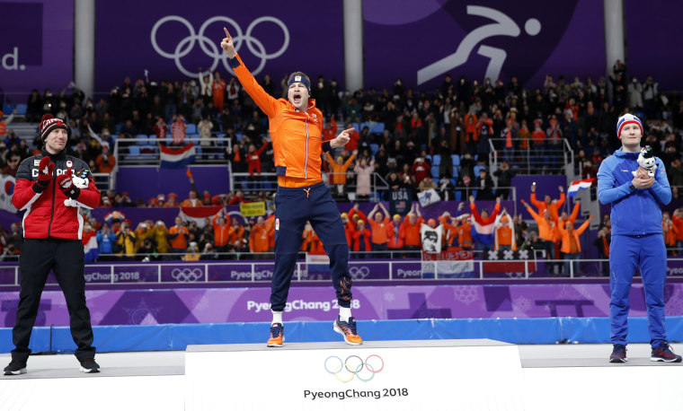 Gold medalist and new Olympic record holder Sven Kramer of The Netherlands celebrates with silver medalist Ted-Jan Bloemen of Canada, left, and bronze medalist Norway's Sverre Lunde Pedersen, right, after the men's 5,000 meter race at the Gangneung Oval on Feb. 11.