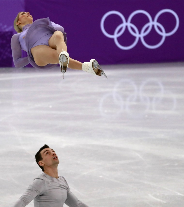 Chris Knierim of the U.S. looks up to his sister and skating partner Alexa Scimeca Knierim during the pair free skating of the figure skating team event competition on Feb. 11.