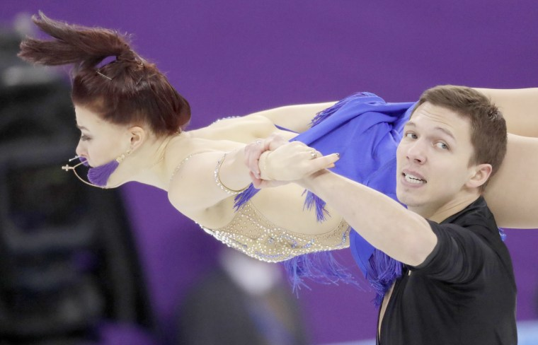 Russian athletes Ekaterina Bobrova and Dmitri Soloviev perform during the ice dance short dance team event on Feb. 11.