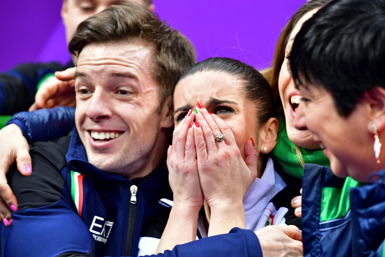 Italy's Valentina Marchei and Ondrej Hotarek react after competing in the figure skating team event pair skating free skating on Feb. 11.