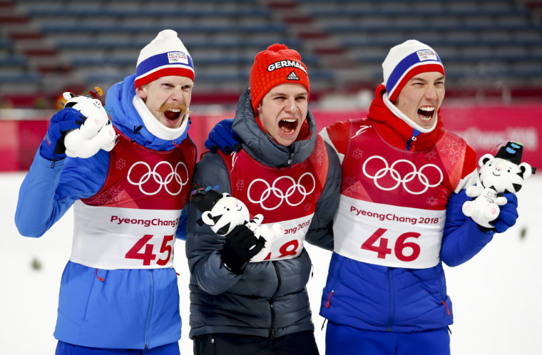 Gold medal winner Andreas Wellinger, of Germany, flanked by silver medal winner Johann Andre Forfang, of Norway, right, and bronze medal winner Robert Johansson, of Norway, pose after the men's normal hill individual ski jumping competition on  Feb. 11.