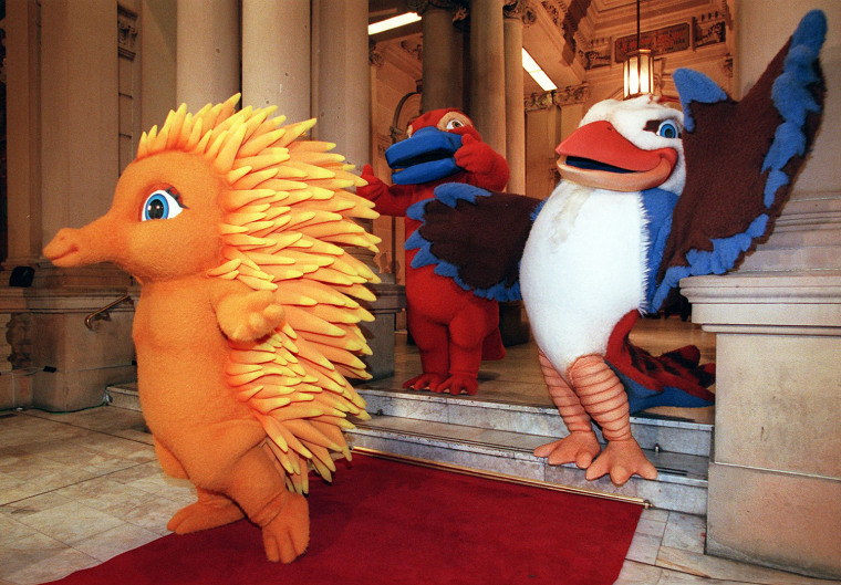 The mascots for the Sydney 2000 Olympic Games make a grand entry at their first public appearance in Sydney 28 May. The mascots are based on native Australian animals - they are Millie, the Echidna (L) - Syd, the Platypus (C) and Olly, the Kookaburra (R)