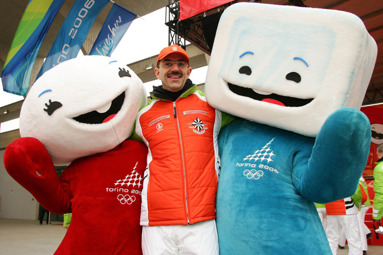 President of the National German Olympic Commitee and Chef de Mission Klaus Steinbach poses with the mascots of the Olympics Neve (L), a snowball, and Gliz, an ice cube, after the raising of the flag ceremony at the Olympic Village prior to the Turin 2006 Winter Olympic Games on February 7, 2006 in Turin, Italy. The opening ceremony will take place on February 10, 2006 at the Olympic Stadium.