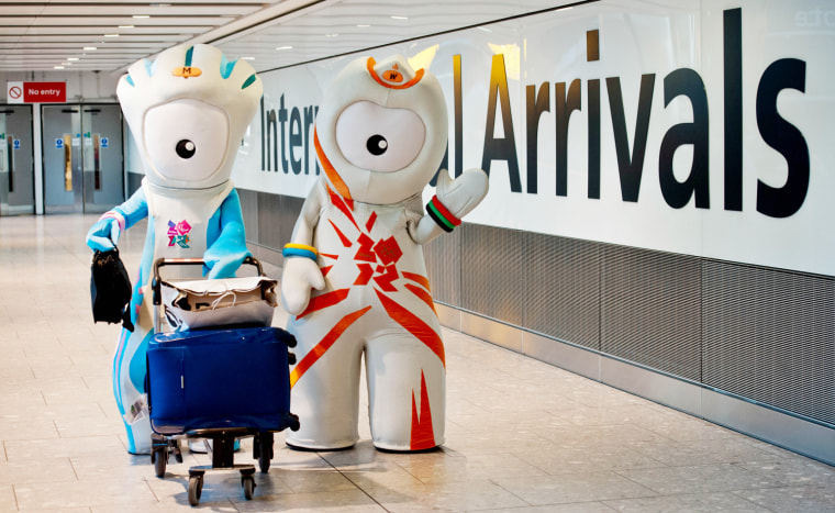Olympic Mascots Wenlock and Mandeville pose at Heathrow Airport as athletes arrive in London on July 23, 2012, four days ahead of the start of the London 2012 Olympic Games.